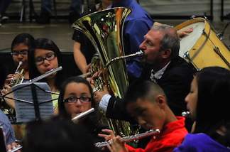 Richard Schermer plays the tuba with intermediate band students during an end-of-the-year concert at Nogales High School in Rowland Heights on June2, 2011.