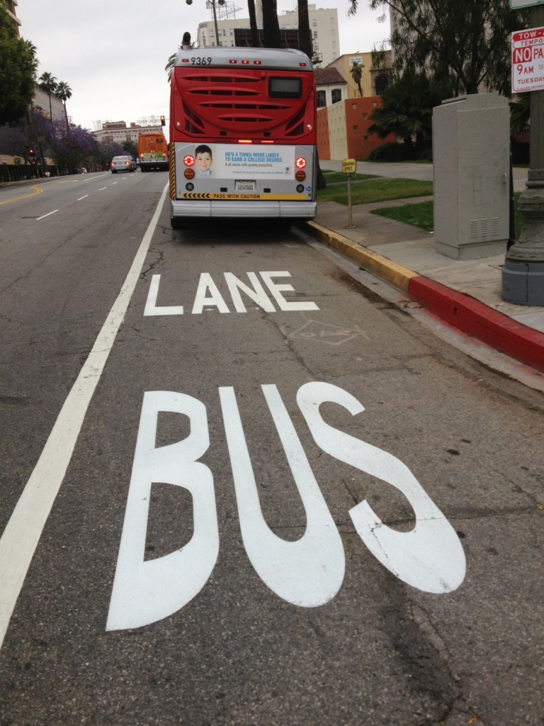 Dedicated bus-only lanes have been painted on Wilshire Boulevard, like this sign at South Park View Street.
