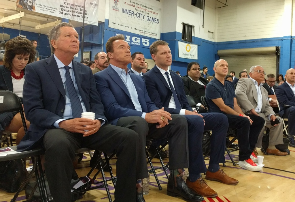 Ohio Governor John Kasich, former California Governor Arnold Schwarzenegger and Assemblyman Chad Mayes (R-Yucca Valley) sit at the beginning of the first New Way California event on March 21, 2018 in Los Angeles.