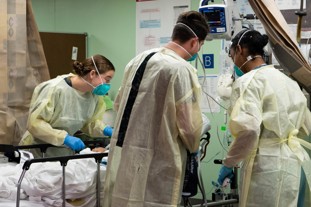 In this handout released by the U.S. Navy, Sailors assigned to the hospital ship USNS Mercy (T-AH 19) treat the first patient from Los Angeles medical facilities March 29.
