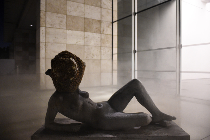Pierre Huyghe's exhibition at LACMA includes this sculpture whose head is covered by a bee hive.