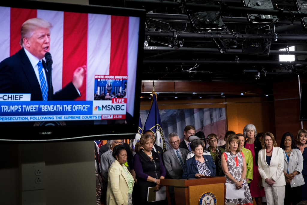 With President Trump displayed on a television monitor, members of the House Democratic conference hold a press conference concerning President Donald Trump's controversial tweets, on Capitol Hill, June 29, 2017 in Washington, DC.