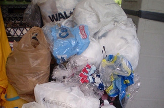 A pile of plastic bags await recycling.