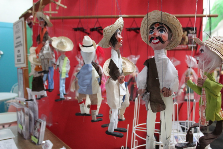 Marionettes hang inside at the small gift store.