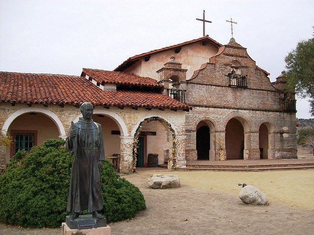 Mission San Antonio de Padua in Monterey County, CA has the statue of Father Junipero Serra outside.