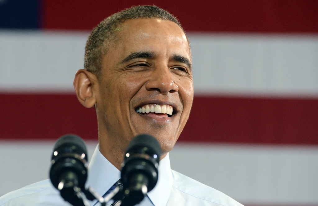 US President Barack Obama smiles as he speaks at the Costco in Lanham, Maryland, on January 29, 2014 to highlight the importance of raising the federal minimum wage for all Americans.