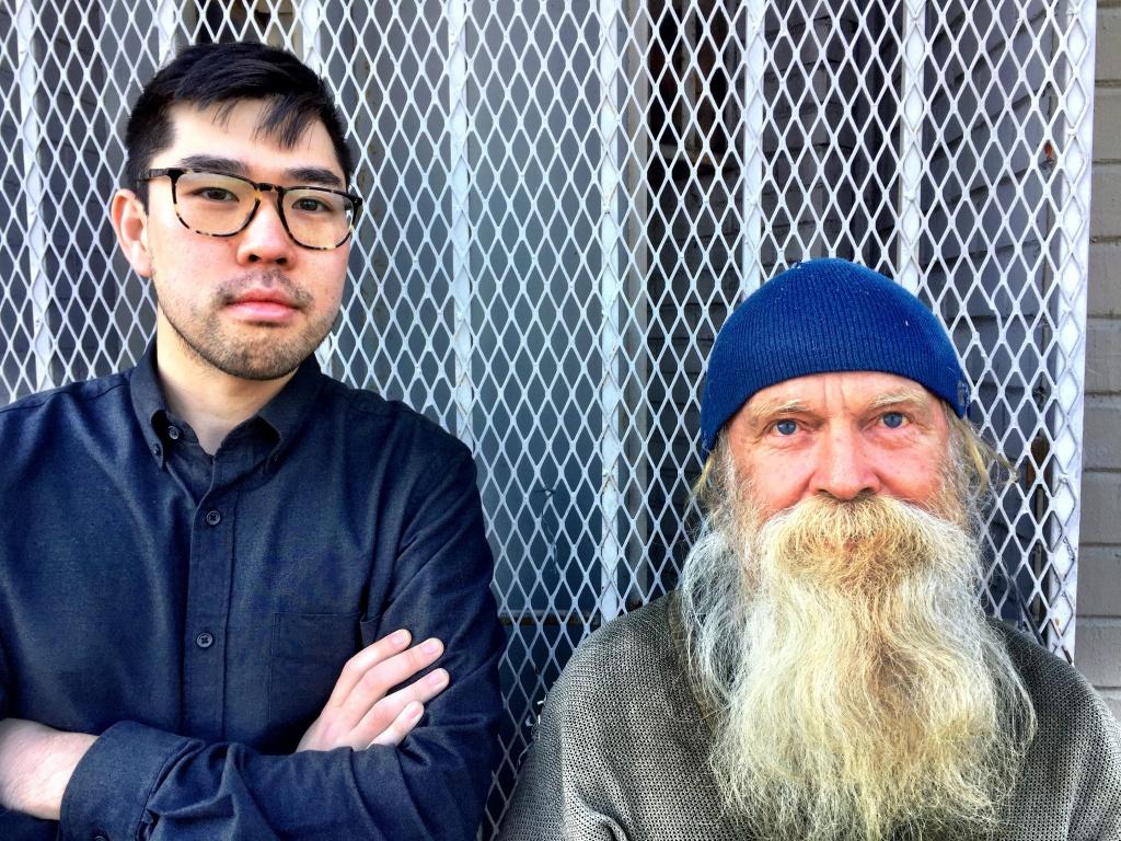 LA Downtown News Reporter Eddie Kim and homeless man Raymond on Crocker Street in downtown LA's Skid Row