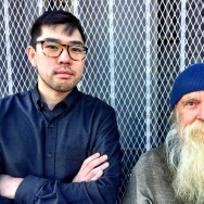 LA Downtown News Reporter Eddie Kim and homeless man Raymond on Crocker Street in downtown LA's Skid Row
