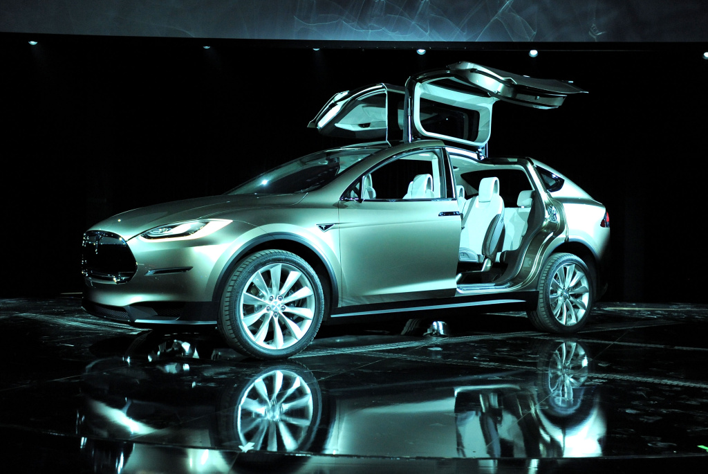 Tesla's recently revealed Model X crossover electric vehicle. The company has just announced a new sale of shares to raise money — and avoid payment problems with a Department of Energy loan.