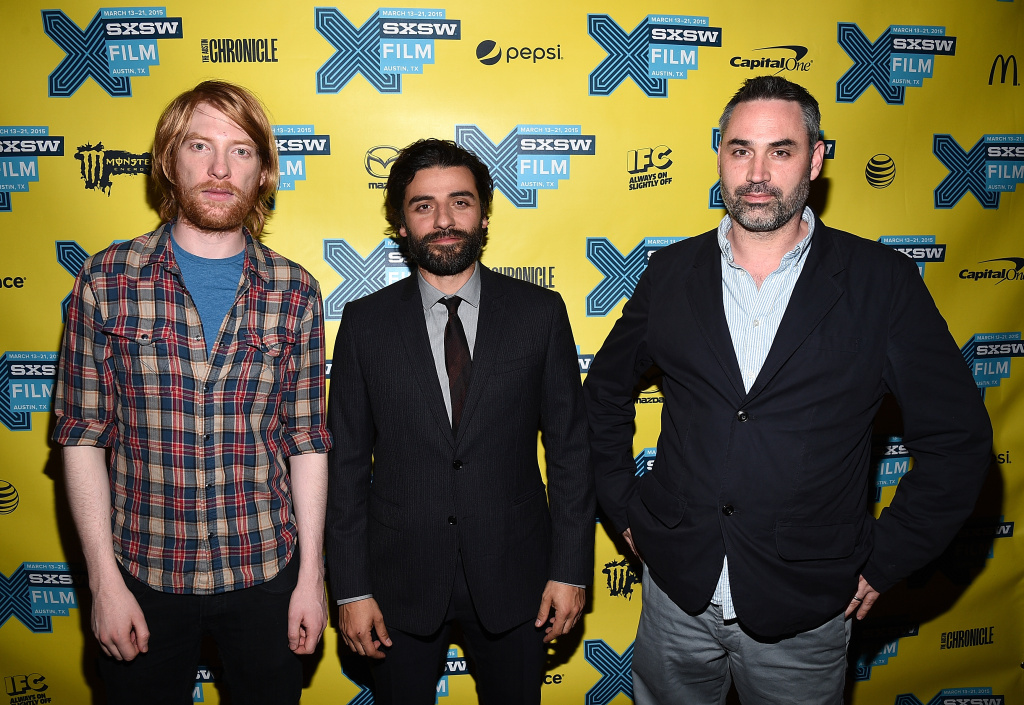 (L-R) Actor Domhnall Gleeson, actor Oscar Isaac and director Alex Garland arrive at the premiere of