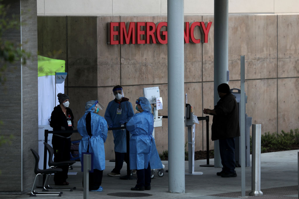 Healthcare professionals screen people entering the emergency room at Highland Hospital on March 26, 2020 in Oakland, California.