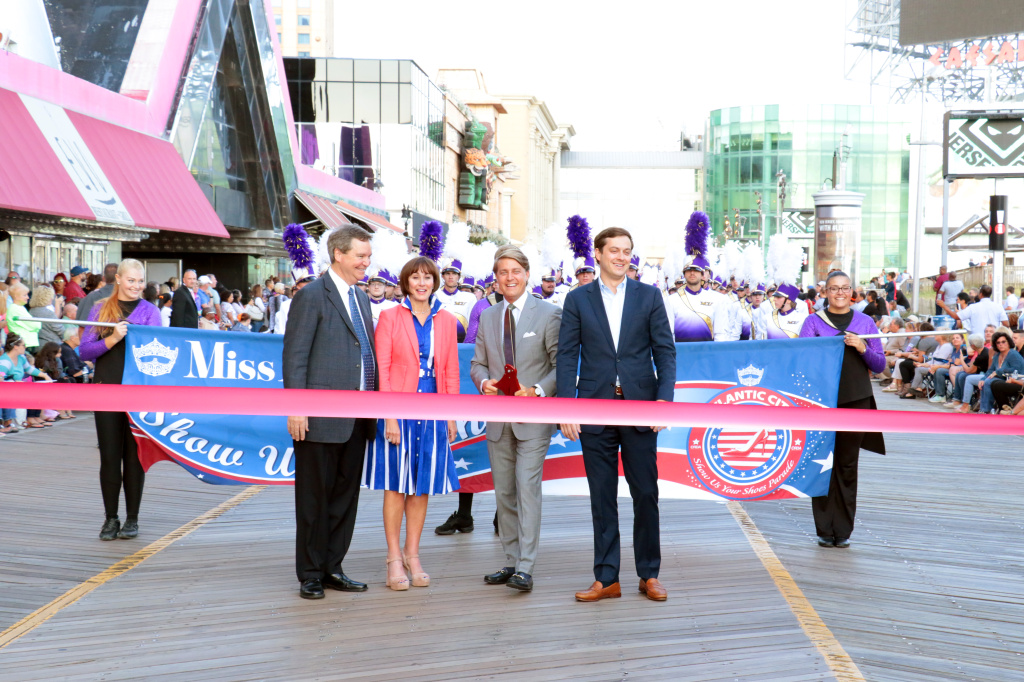Miss America Organization Executive Committee members Executive Chairman Sam Haskell, III, CHairman of the Board Lynn H. Weidner, President and COO Josh Randle and Eli Popicg participate in a ribbon-cutting ceremony to start the Miss America 2018 - Show Me Your Shoes Parade on September 9, 2017 in Atlantic City, New Jersey.