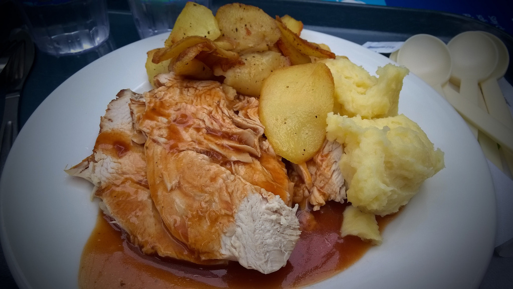 Roasted turkey with potatoes.