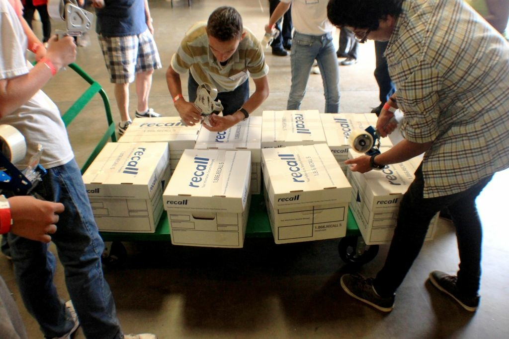 Volunteers pack up thousands of pounds of food as part of a Rotary Club-sponsored drive on Saturday at Second Harvest Food Bank in Riverside. Photo: Steven Cuevas/KPCC