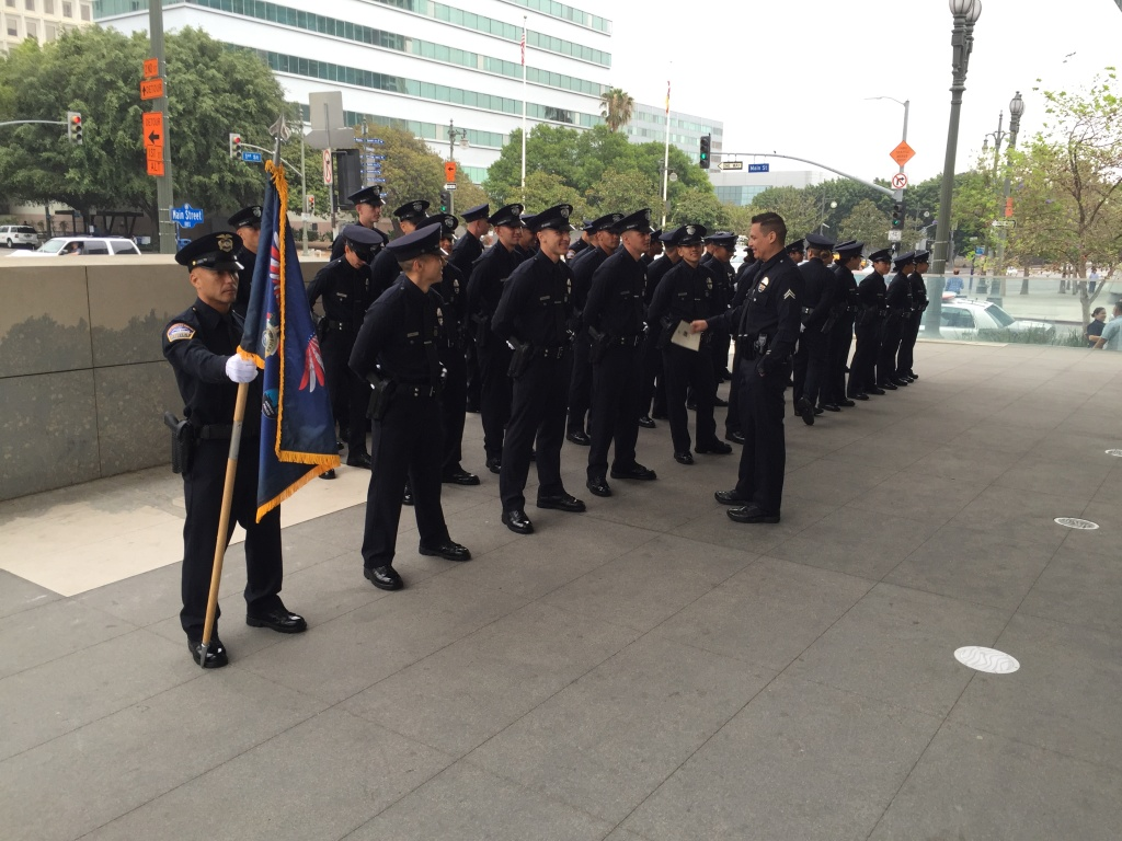 Los Angeles police recruits get ready for a graduation ceremony on Friday, July 8, 2016 outside the department's headquarters.
