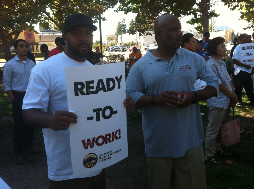 Construction workers, advocates and community leaders participate in a jobs rally at Leimert Park in South Los Angeles on Sept. 7, 2013. Workers from the surrounding neighborhoods are lobbying to be hired for thousands of jobs along the upcoming Crenshaw/LAX Transit Corridor Project when construction begins in the Spring of 2014.