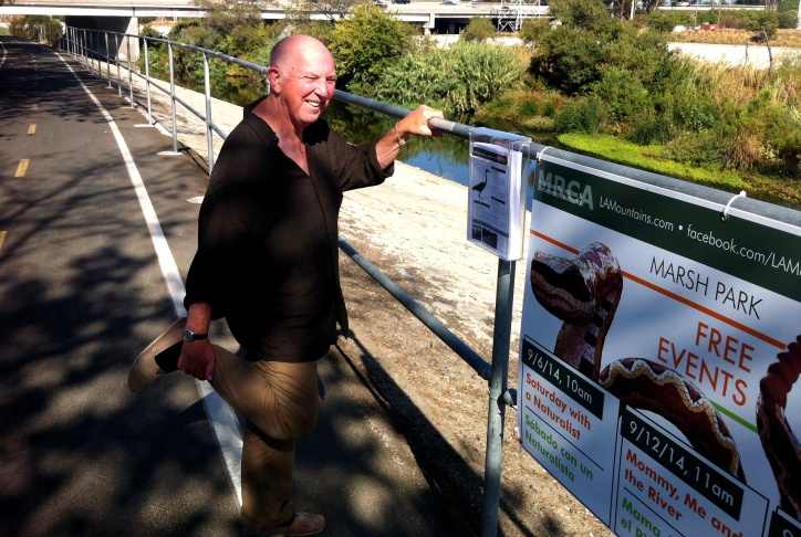 Lewis MacAdams, champion of the LA River and head of FoLAR, imitates one of the herons that lives along the river.