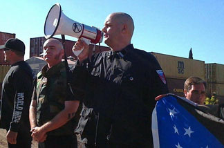 Water board candidate and white supremacist Jeff Hall (with bullhorn) at an anti-illegal immigration rally in Riverside last year.