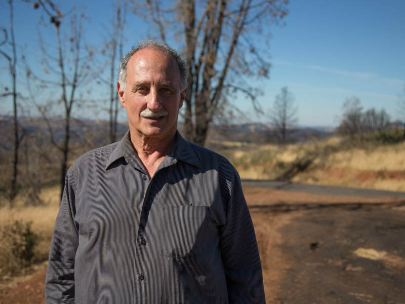 Apple farmer and former Calaveras County Supervisor Steve Wilensky is pictured on a hillside burned in the 2015 Butte Fire, Monday, October 20, 2016.