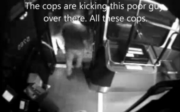 Still from a bus surveillance video showing eyewitnesses talking about the police altercation with a homeless man. The man later died.