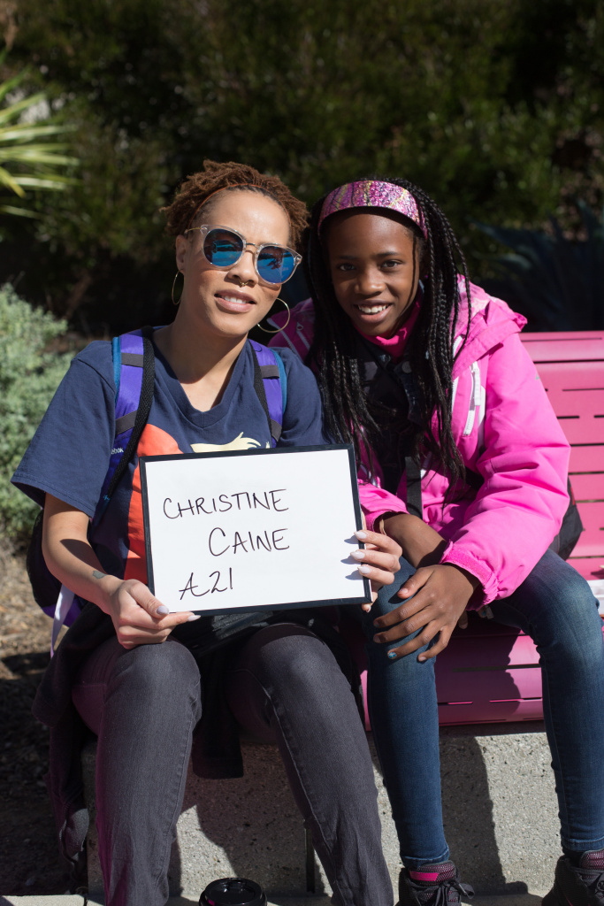Quinn Thompson, 31, and Jenaia Thompson, 10, of Westwood. I picked Christine Caine because she and her non-profit A21 are powerful advocates for the fight against human trafficking. January 20, 2018 at Downtown Los Angeles, California. (James Bernal for KPCC)