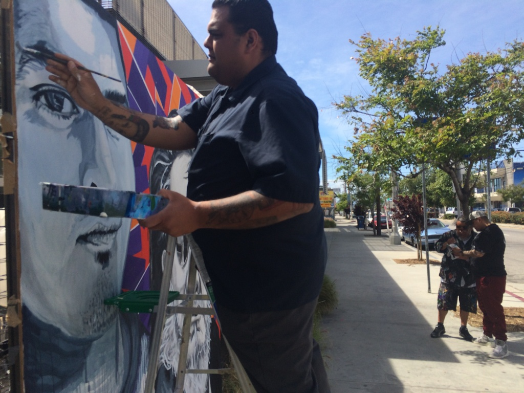 Ray Martinez works on a mural on Van Nuys Blvd just outside Pacoima City Hall. The effort is part of the anti-gang work overseen by artist Manny Velazquez.