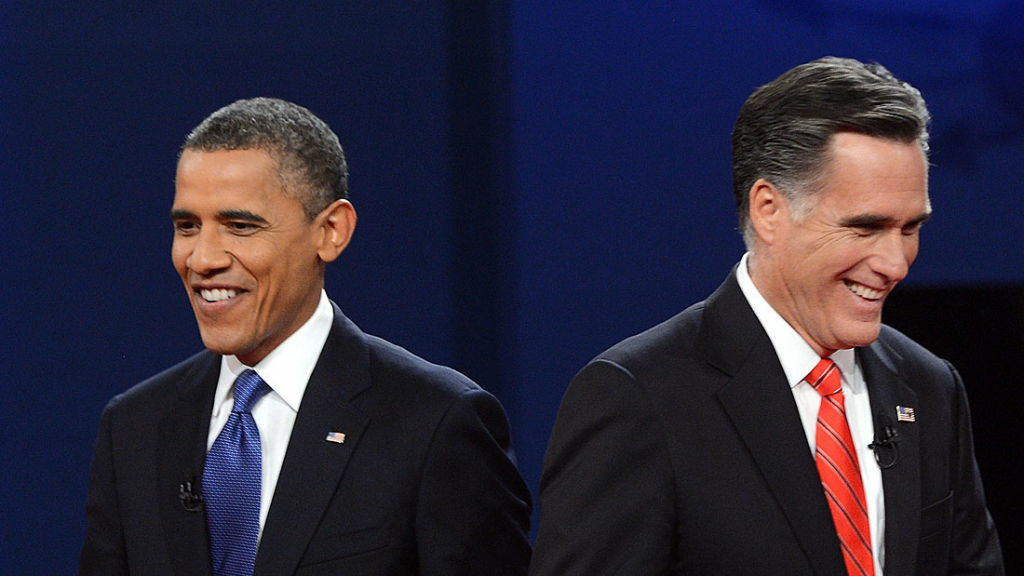 US President Barack Obama (L) and Republican presidential candidate Mitt Romney finish their debate at the University of Denver in Denver, Colorado, October 3, 2012.