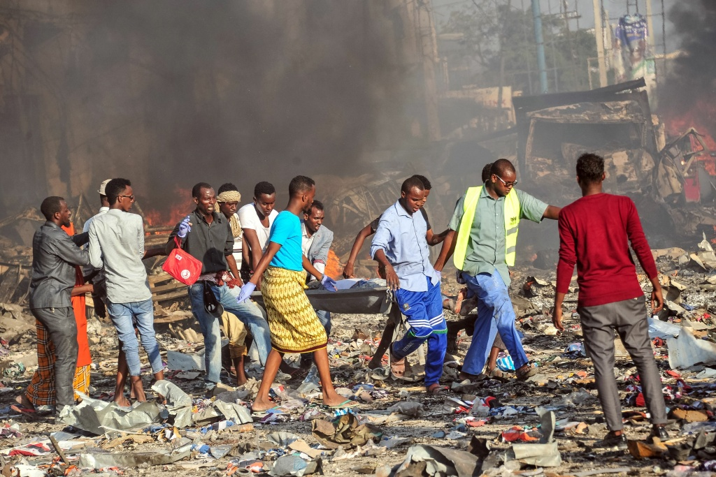 Men carry a stretcher of after a truck bomb exploded in the center of Mogadishu on October 15, 2017.