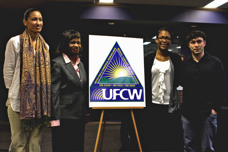 Union members Iila Tiare Alii, Delphine Pregnon, Aryn Adams and Adam Daniels stand with the new logo for the Medical Cannabis and Hemp Workers division of the UFCW.