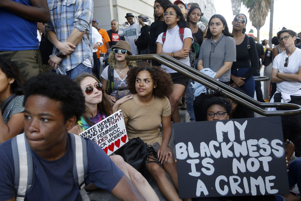 In this file photo, people protest outside City Hall in Los Angeles, Tuesday, July 12, 2016, after the L.A. Police Commission found that the fatal shooting by police of a Redel Jones last year was justified. Activists have long pointed out African-Americans and other minorities are disproportionately targeted by police. The commission called for a closer look at racial profiling Tuesday following an LAPD report that showed the department has not upheld any allegations of biased policing since 2013.