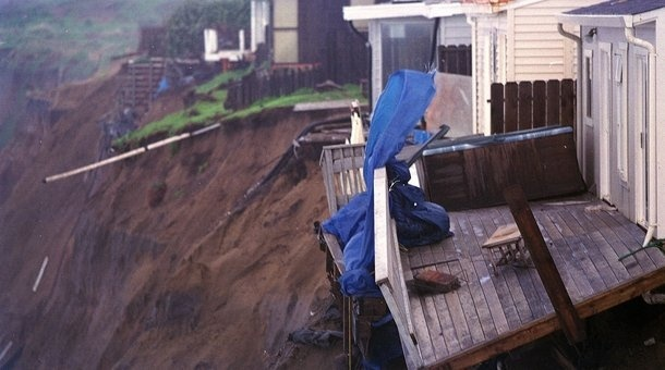 People from the village of Shiran, approxinately 480 miles north of the Peruvian capital Lima, view a damaged sewage line caused by flooding of the Chicana River due to heavy rains attributed to the 'El Nino' effect in 1998.