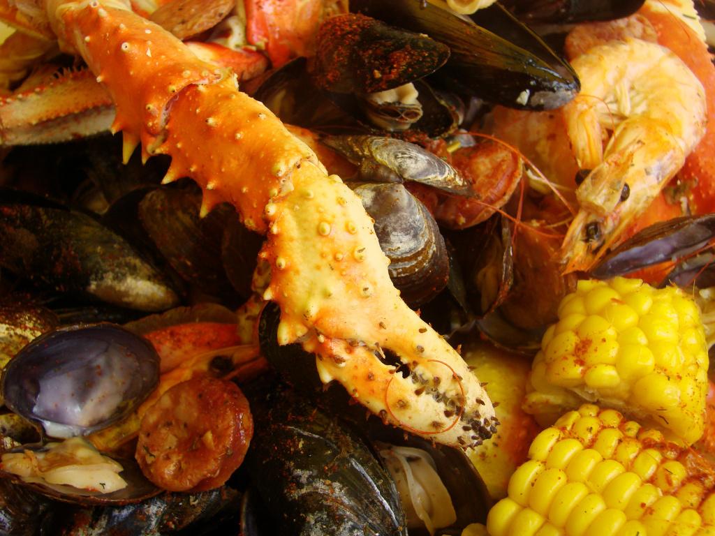 Seafood heaped onto a table.