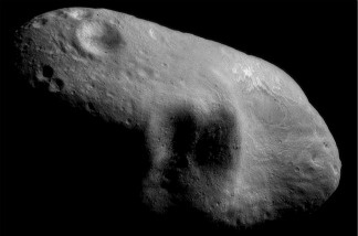 An image mosaic of the asteroid Eros, with sunlight coming from the northeast, taken by the robotic NEAR Shoemaker space probe.