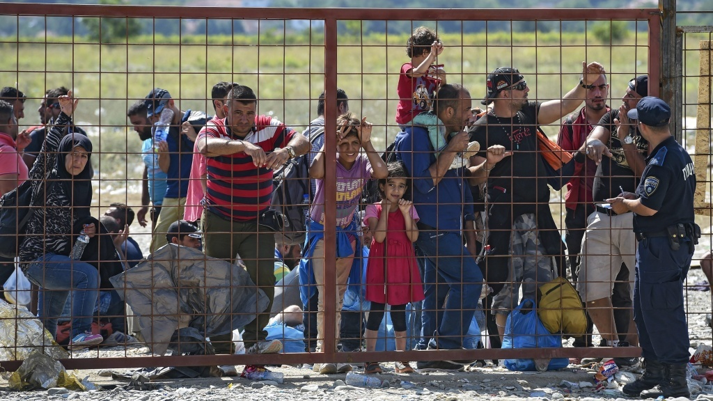A group of migrants wait for permission to enter a registration camp near the town of Gevgelija, Macedonia, on Monday.
