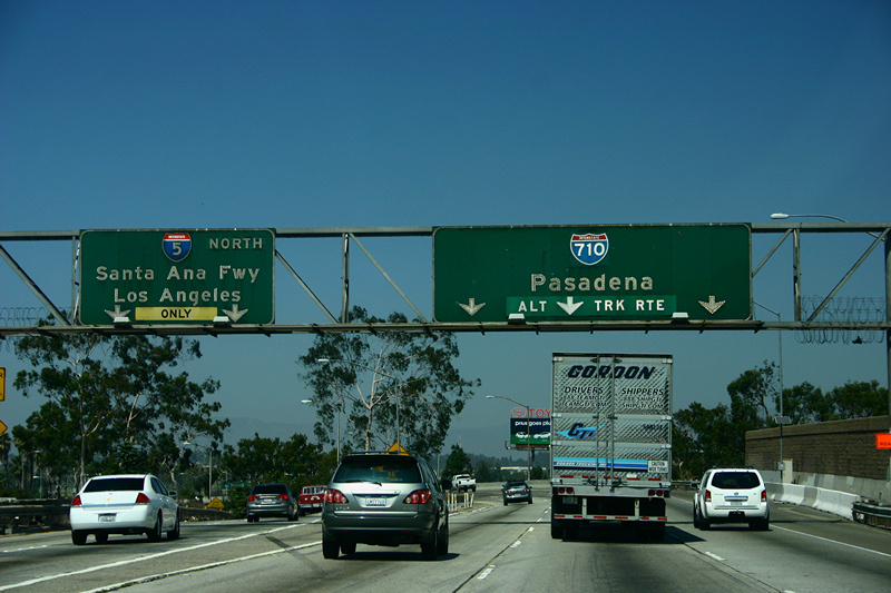 File: An I-5 exit sign with an I-710 pull-through sign, northbound.