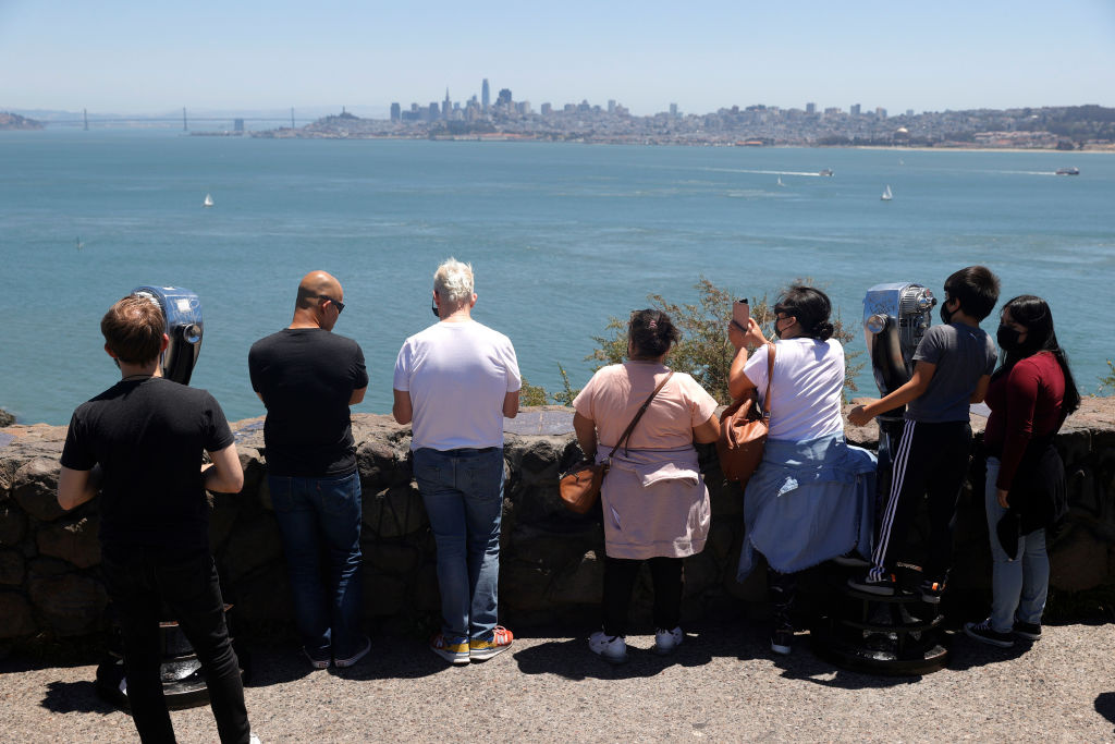 Tourists gather at the Golden Gate Bridge vista point on June 15, 2021 in Sausalito, California.