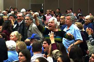 Screen capture from OC Register video of event attendees at UC Irvine presentation by Michael Oren.