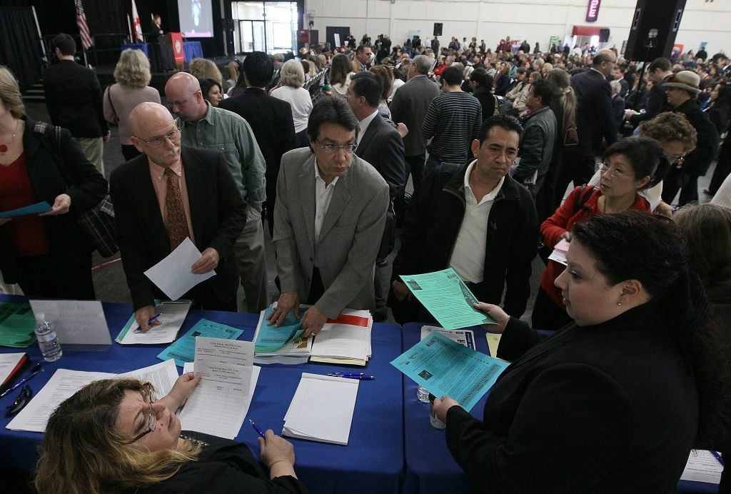 Job seekers speak to recruiters during a 'Boot Camp' for job seekers at the San Mateo County Expo Center in San Mateo, California.