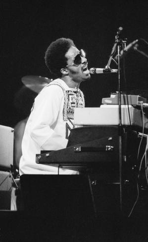 Stevie Wonder uses a pair of headphones in London, England in 1974.