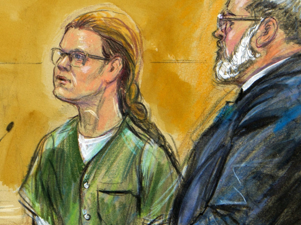 In this courtroom sketch, Maria Butina, left, is shown next to her attorney Robert Driscoll, before U.S. District Judge Tanya Chutkan, during a hearing in December.
