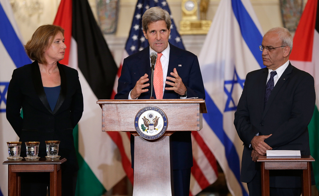 U.S. Secretary of State John Kerry (C) makes a statement with Israeli Justice Minister Tzipi Livni (L) and Palestinian chief negotiator Saeb Erekat (R) during a press conference on the Middle East Peace Process Talks at the Department of State.