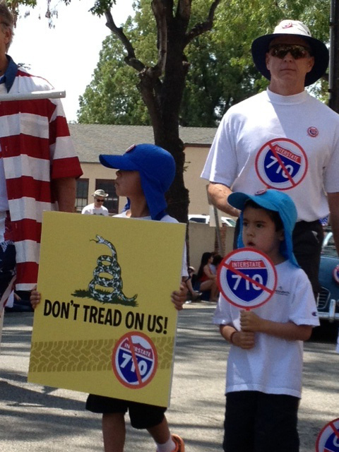 Opponents to the expansion of the 710 freeway march at the July Fourth parade in South Pasadena.