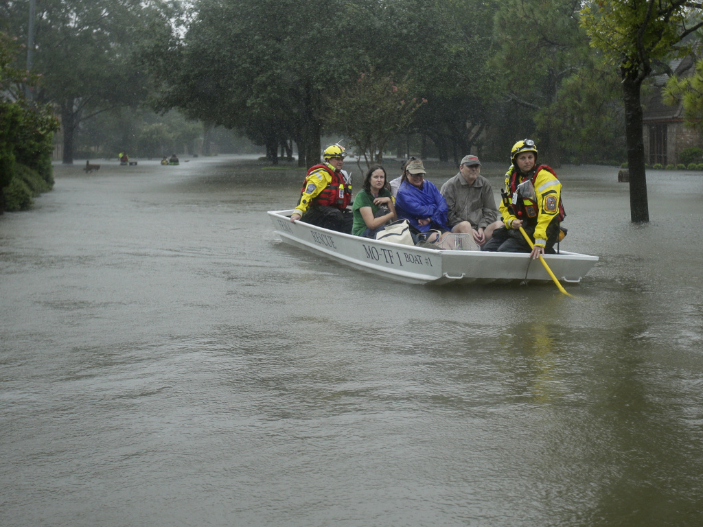 A FEMA rescue team evacuates people from a neighborhood inundated by floodwaters from Tropical Storm Harvey on Monday, Aug. 28 in Houston, Texas.