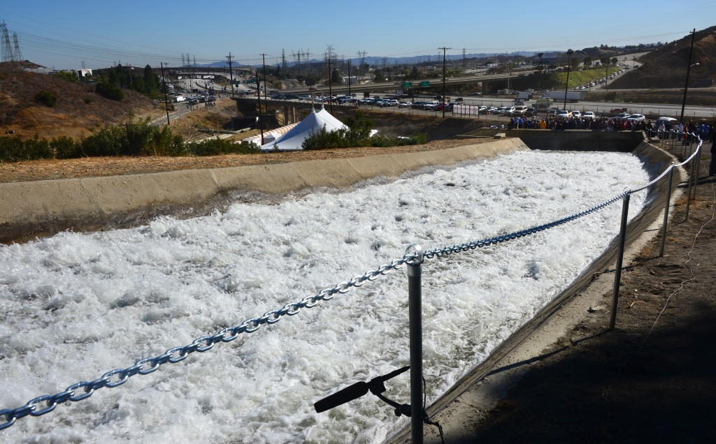 A microphone records the sounds of gushing water flowing following a re-enactment of the moment the Los Angeles Aqueduct gates were first opened 100 years earlier, in this November 5, 2013 file photo taken in Sylmar, California. William Mulholland conceived the gravity-fed channel to slake the growing city's thirst and famously quipped,