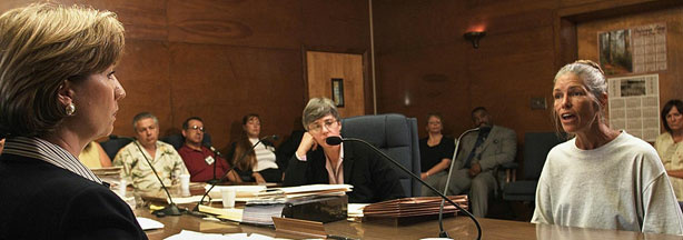 File photo: Sheron Lawin (L), a member of the Board of Prison Terms commissioners, listens to Van Houten (R), after her parole was denied in June 2002.