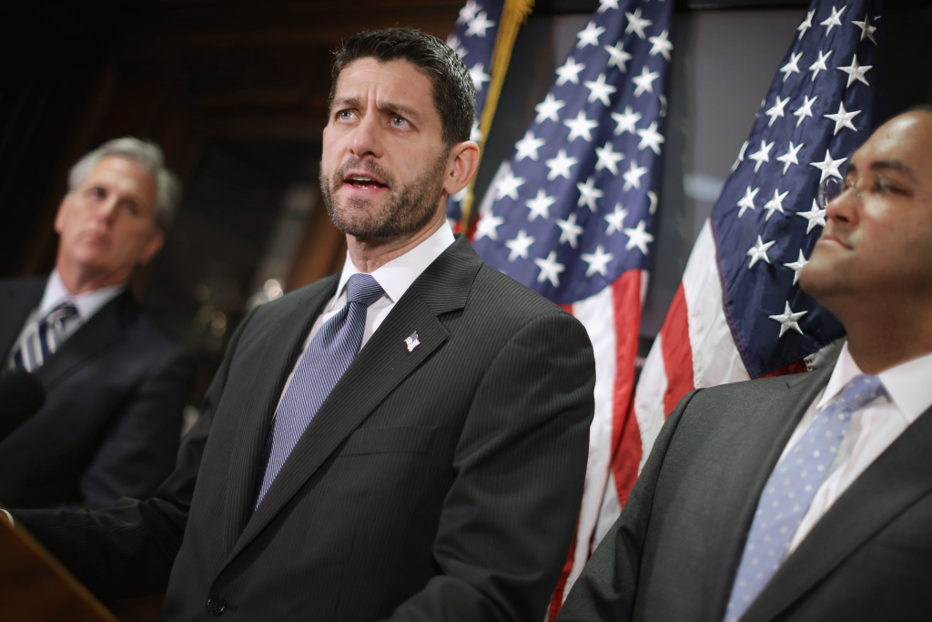 Speaker of the House Paul Ryan (R-WI) (center) and members of the House GOP leadership, including Majority Leader Kevin McCarthy (R-CA) (left), hold a news briefing following the weekly Republican Conference meeting at the U.S. Capitol Dec. 8, 2015, in Washington, DC.