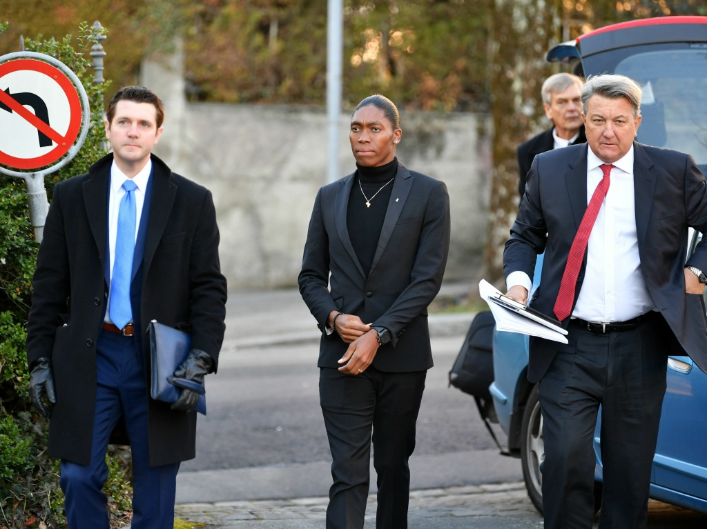 South African Olympic champion Caster Semenya (center) and her lawyer, Gregory Nott (right), arrive for a hearing at the Court of Arbitration for Sport in Switzerland in February.