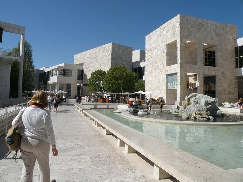 A woman walks through the courtyard at the J. Paul Getty Museum.