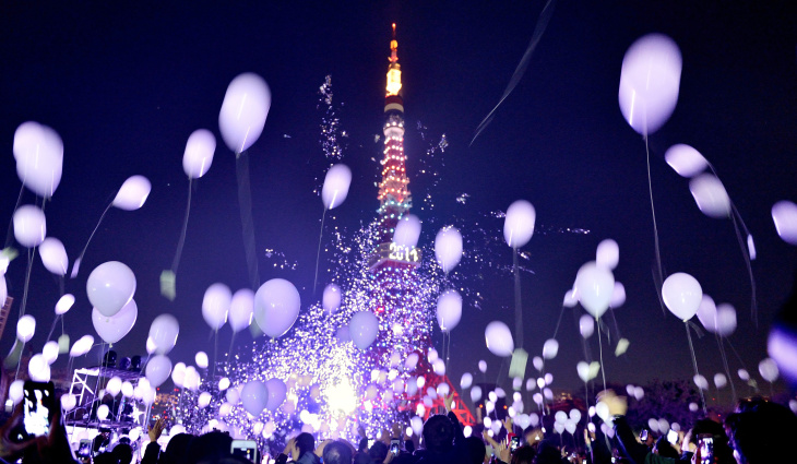 People release balloons to celebrate the New Year during the annual countdown ceremony by the Prince Park Tower Tokyo on Jan. 1, 2014. Some 2,000 balloons were released in the air carrying visitors' wishes.
