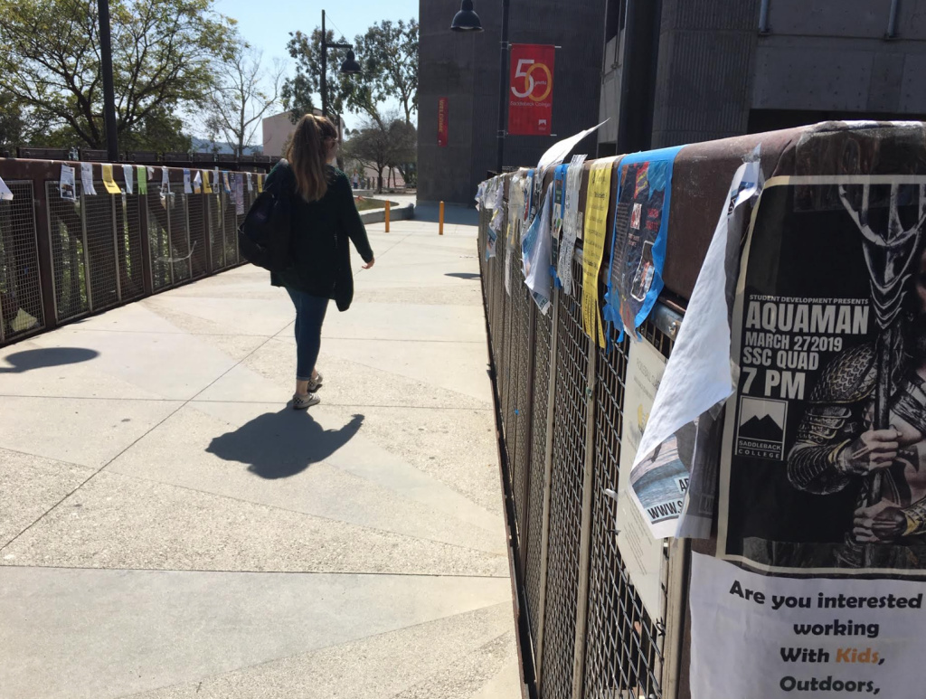 Posters hang on a walkway at Saddleback College in Mission Viejo, a local campus that's twice been hit with white supremacist propaganda posters in recent months.